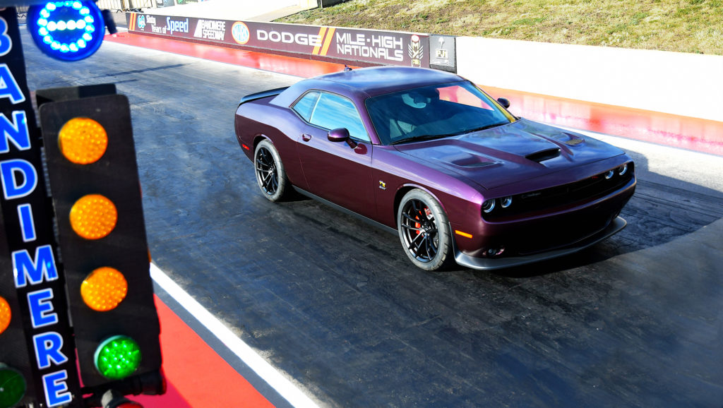 """The 2019 Dodge Challenger R/T Scat Pack 1320 is a drag-oriented, street-legal muscle car designed with the grassroots drag racer in mind. Named for the quarter-mile distance (1,320 feet), the Challenger R/T Scat Pack 1320 is powered by the stalwart 392 HEMI® V-8 that delivers 485 horsepower and 475 lb.-ft. of torque. Running the quarter-mile in 11.7 seconds at 115 mph makes the showroom-stock Challenger R/T Scat Pack 1320 the fastest naturally aspirated, street-legal muscle car available. Note the vehicle is shown in custom """"Black Eye"""" high-impact exterior paint being used to gauge interest as potential future production exterior color."""
